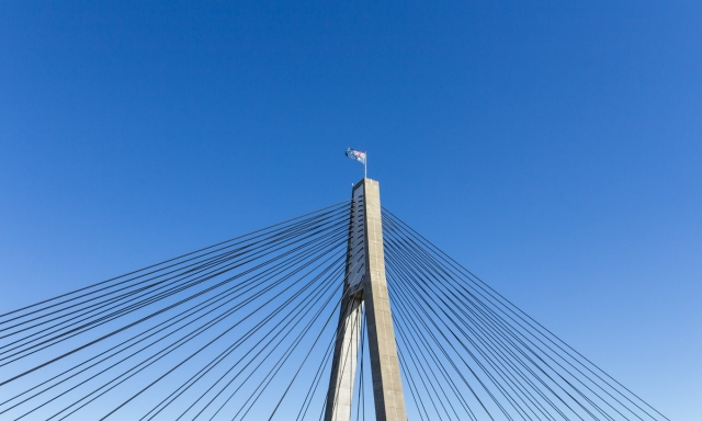 Picture of Bridge behind blue sky